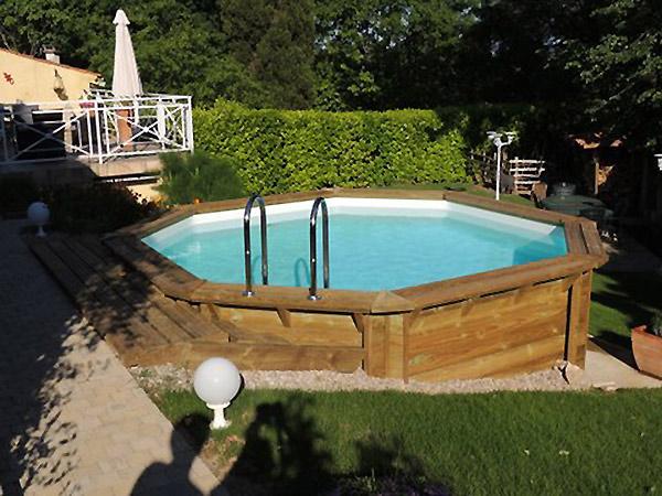 Galerie photos de piscines en bois semi enterr es for Piscines semi enterrees bois